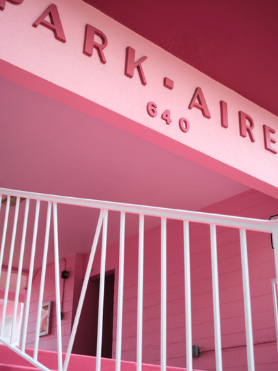 The Park-Aire, a vibrant pink apartment complex in Winter Park, Florida.