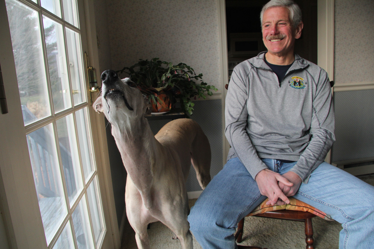 Mike Ball sits with his dog at his home in York County, Pennsylvania, in 2016. Ball is a long-distance runner and member of the 50 States Marathon Club.
