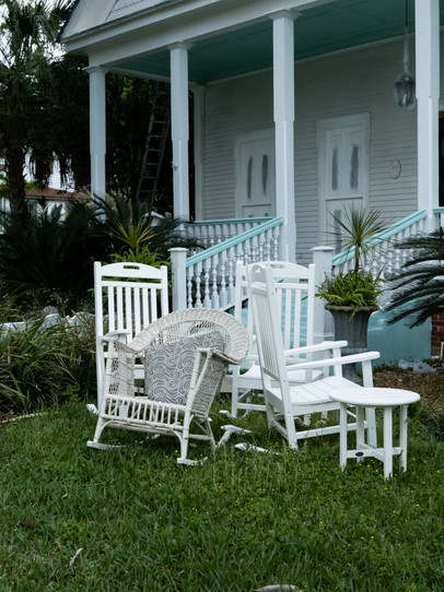 A cluster of wicker chairs outside a house in Fernandina Beach, Florida.