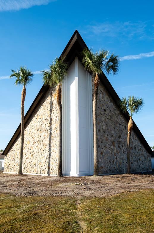 Four palm trees outside a church in Orlando, Florida.