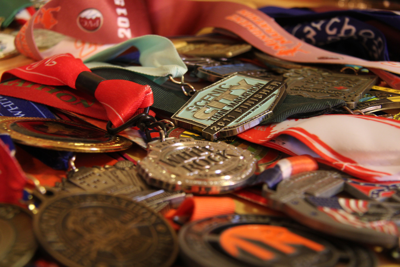 A collection of Mike Ball's running medals.