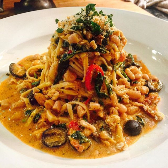 Fettuccine in a Vodka Tomato Sauce with Olives, Crab, Cannellini Beans and Kale