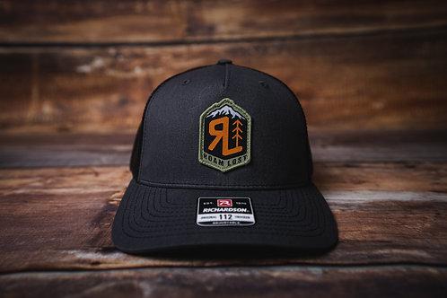 RL BADGE DARK GREY TRUCKER HAT