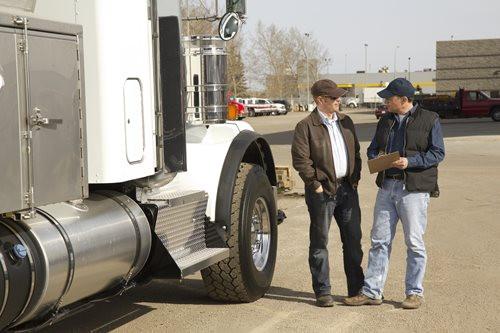 Trucker Going Through a DOT Inspection