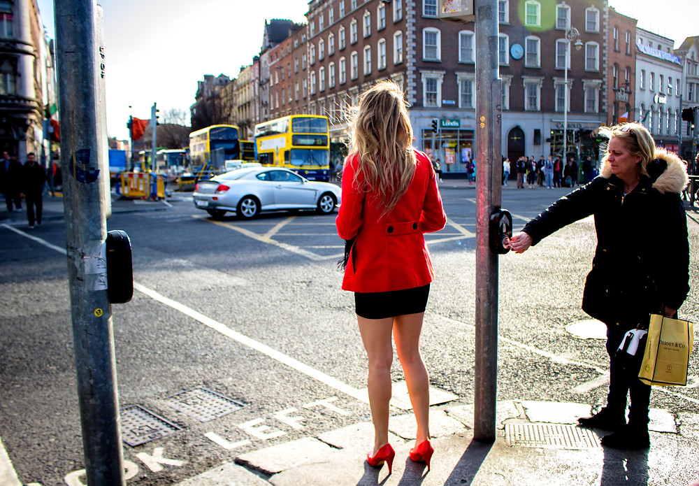 Fashion, David Bowie. A well dressed woman at the traffic lights, street photography
