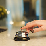 woman-ringing-hotel-reception-service-be