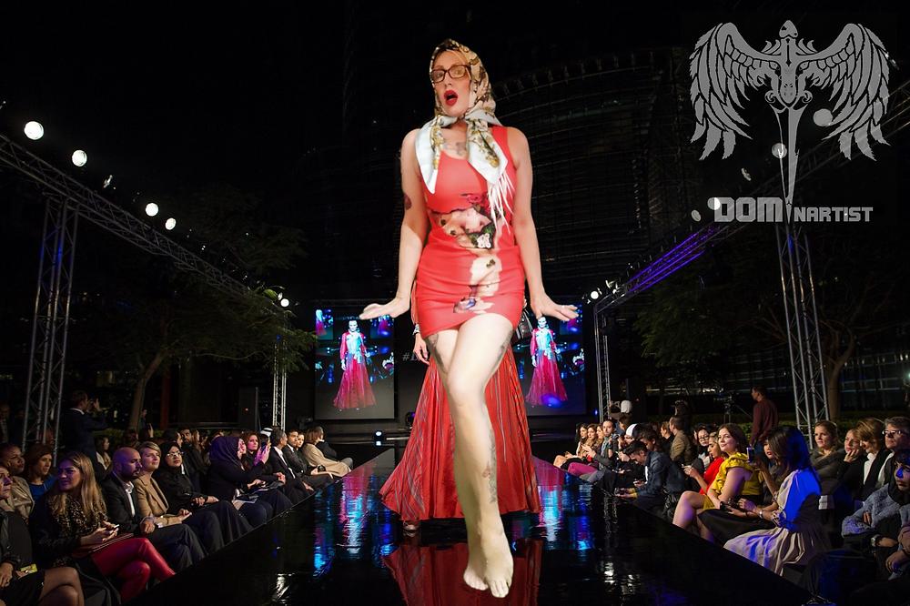fanny blomme modelling a Dominartist dress on the catwalk in Paris