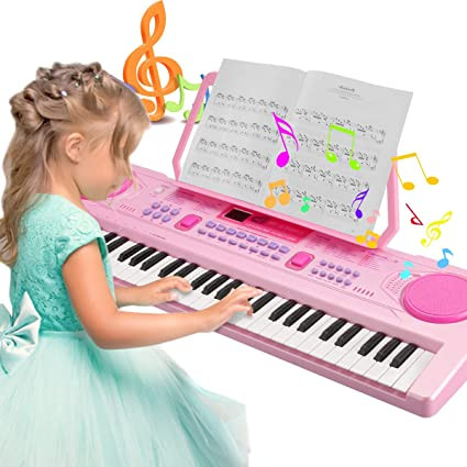 girl in frock playing pink piano