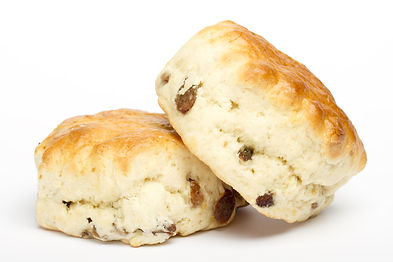Two fruit scones on a white background.j
