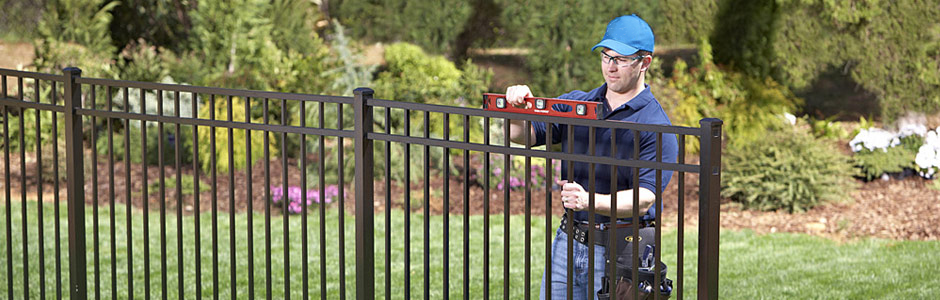 Fence Installer - Checking Fence with Level