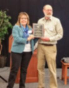 LindaFuerderer, NHAS president presents Dick Boisvert with the Chester C. Price Award in 2018