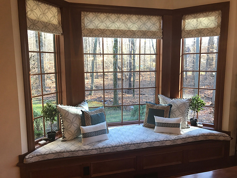 Custom window treatments, pillows and window seat