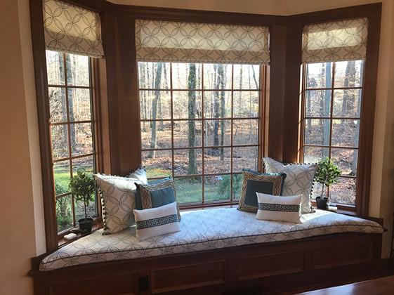 Custom window treatments, pillows and window seat