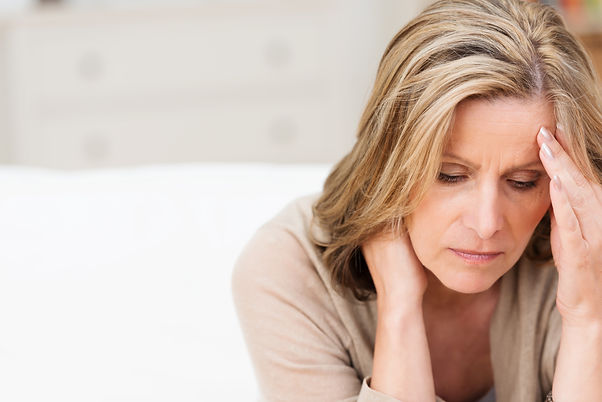 Woman suffering from stress or a headach