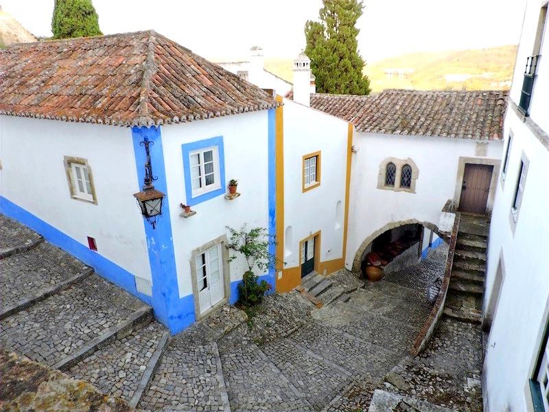 A narrow, cobblestone path in the castle town, Óbidos in Portugal