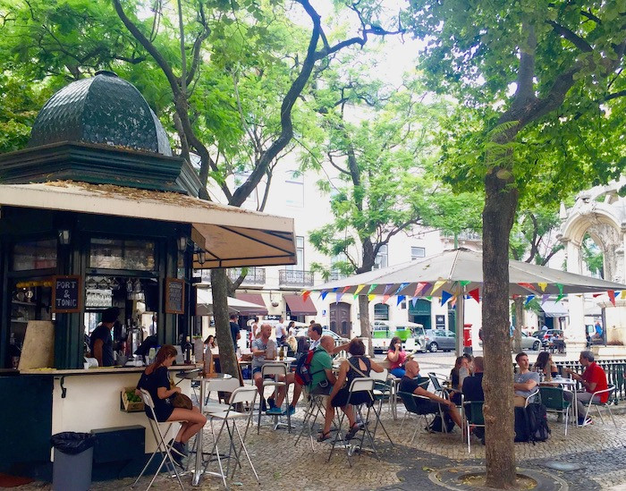 A lively outdoor cafe in Lisbon, Portugal