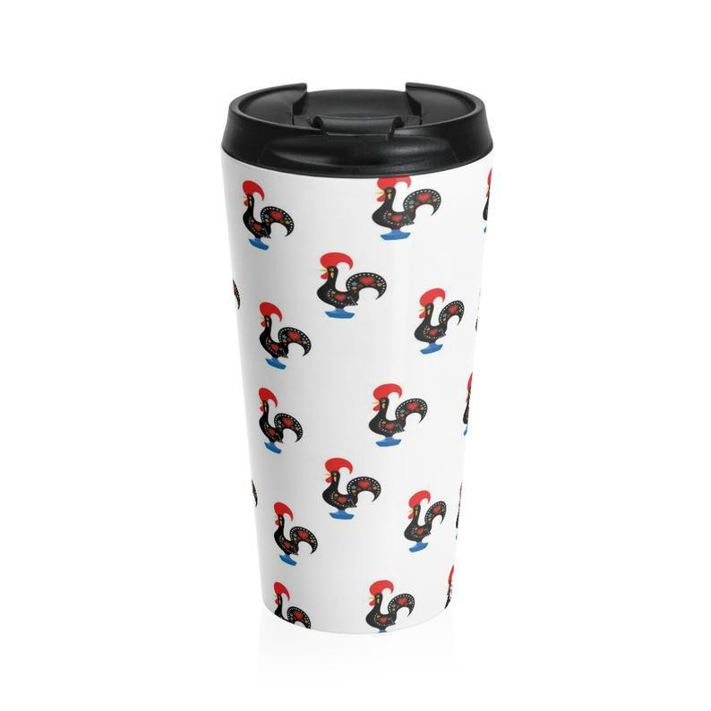 A coffee tumbler with a Galo de Barcelos pattern