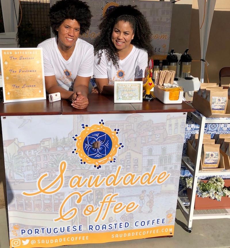 Chantal and Tiffany Barlow sell Saudade Coffee at a booth