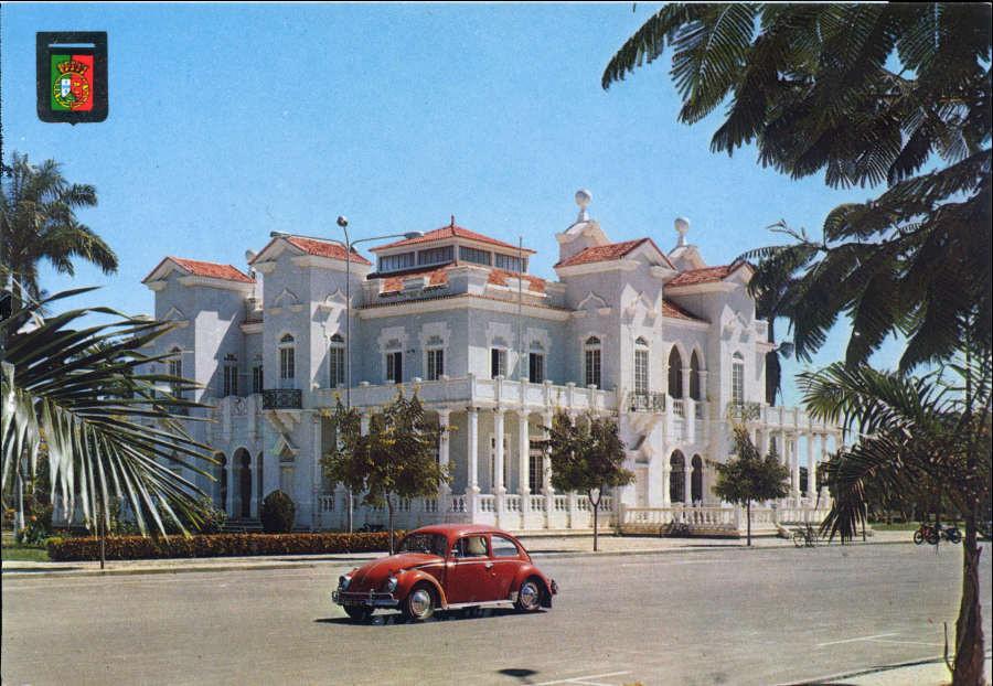 A VW bug drives in front of the Palacio do Comercio in Benguela, Angola circa 1974