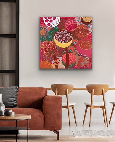 a square painting with red flowers in full bloom is hanging on a neutral wall behind a brown sofa and two wooden chairs
