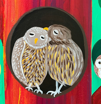 close up on a painting of owls. The two owls are kissing and loving each other