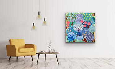 A square painting with soft dandelions is hanging ona white wall next to a yellow couch with hanging lamps
