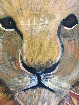 Closeup on a painting of a lion.