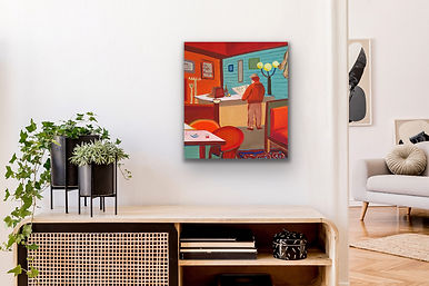 a small square painting representing a cafe scene in Paris is hanging above a wooden table next to an indoor plant