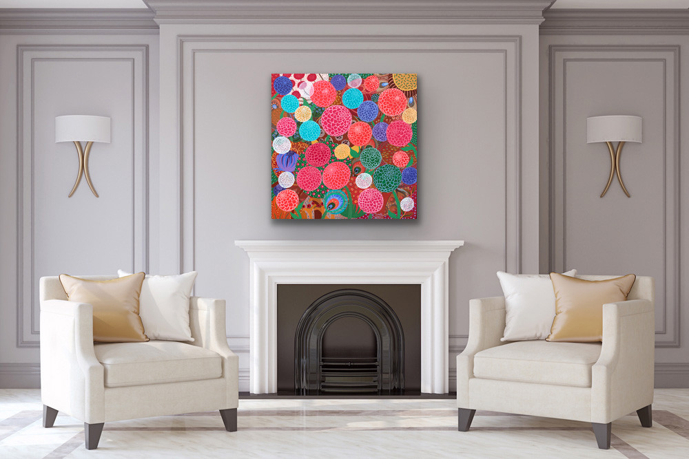 a square painting depicting colorful dahlias hangs above a fireplace in a very elegant living room with white sofa chairs and grey walls
