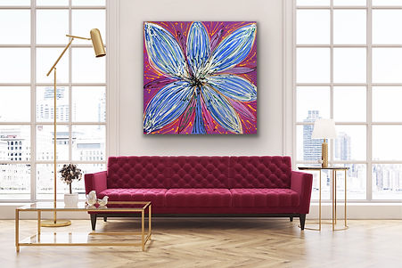 a square painting of a magenta flower opening wide is hanging ona white wall above a burgundy red sofa in between two windows