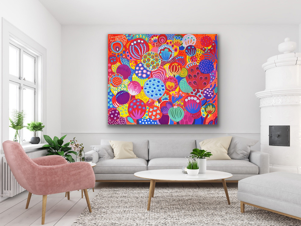 a large contemporary painting represents colorful flowers and seeds with orange and blue tones in a white living room