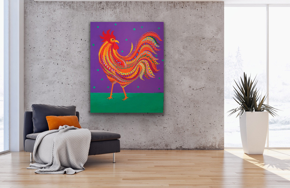 A tall painting depicting a colorful and proud rooster hangs on a concrete wall near a dark grey sofa with an orange pillow