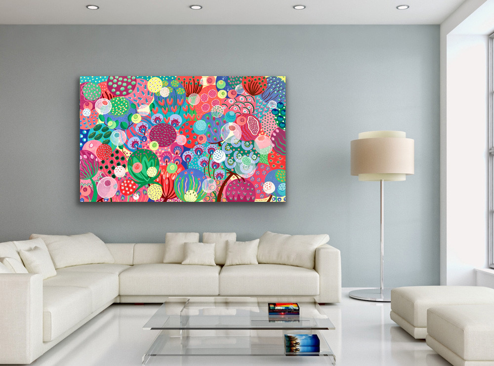 a large colorful seeds painting hangs in a modern living room with a large white sofa