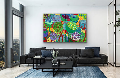 A diptych painting that represents whimsical seeds and flowers is hanging above a dblack leather sofa on a white wall next to a large window