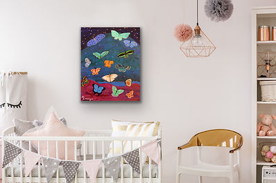 a small painting of butterflies is hanging in a toddler's room