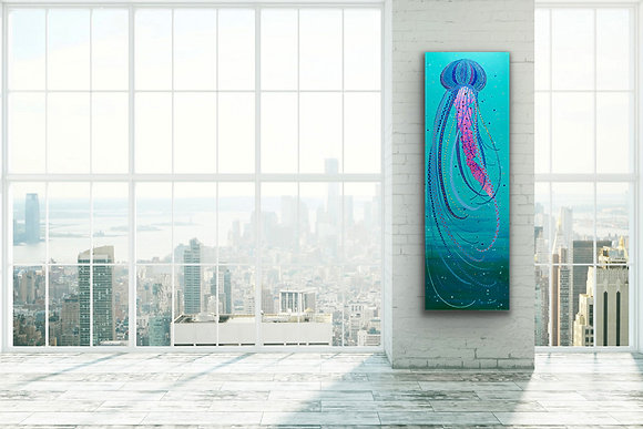 A tall painting of a jellyfish swimming in a turquoise ocean is hanging on a white wall in a loft with large windows