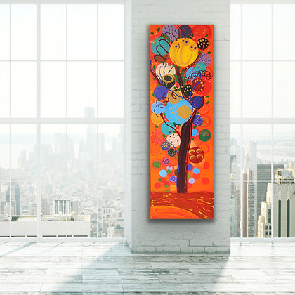 a tall and vibrant painting of a tree with red and orange and blue is decorating this loft with large windows