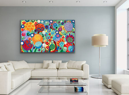 A colorful landscape painting depicting flowers in full bloom is hanging above a large white sofa on a light blue wall