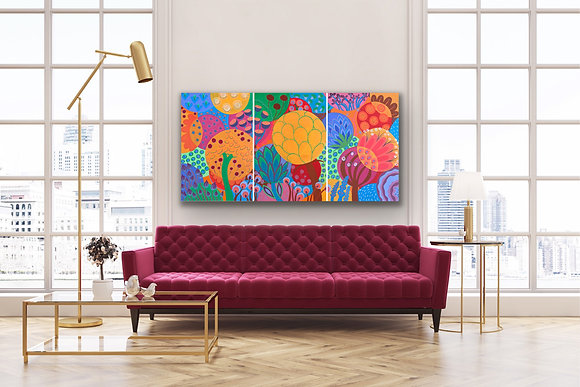 a triptych painting is hanging above a burgundy red sofa. It represents big bubbles that are imaginary flowers