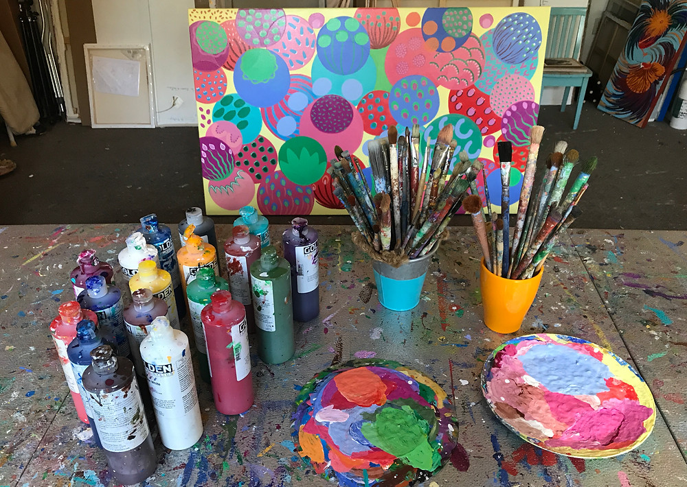 picture of my brushes and paint bottles in my studio