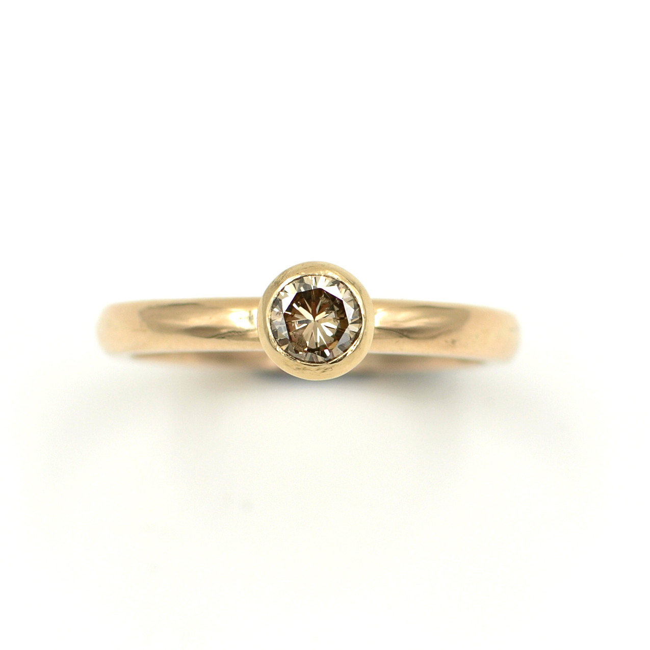 The finished remodelled ring, made from 9ct yellow gold with a 1/3ct light brown diamond in a modern rubover setting