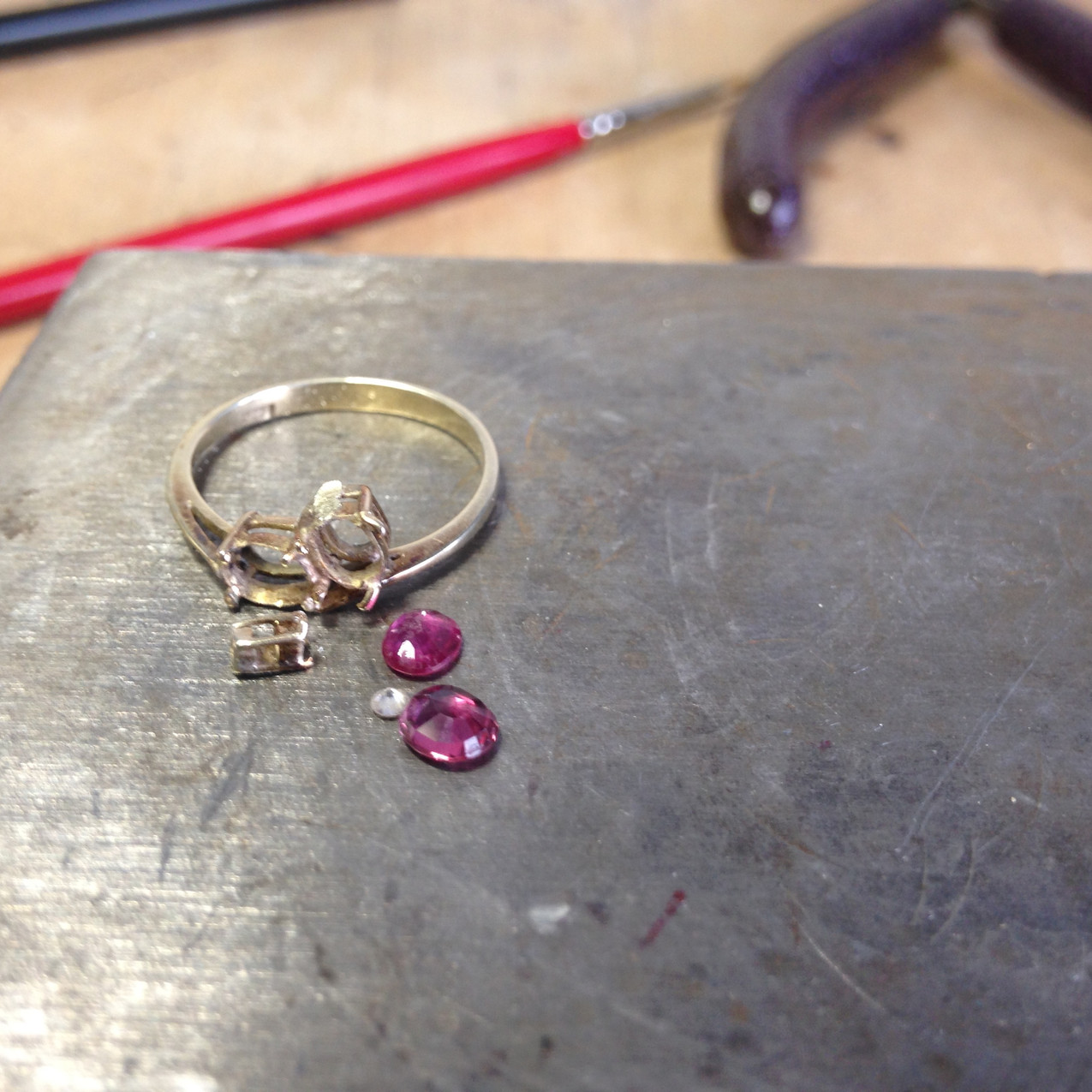 Removal of ruby and diamond stones for ring remodelling.