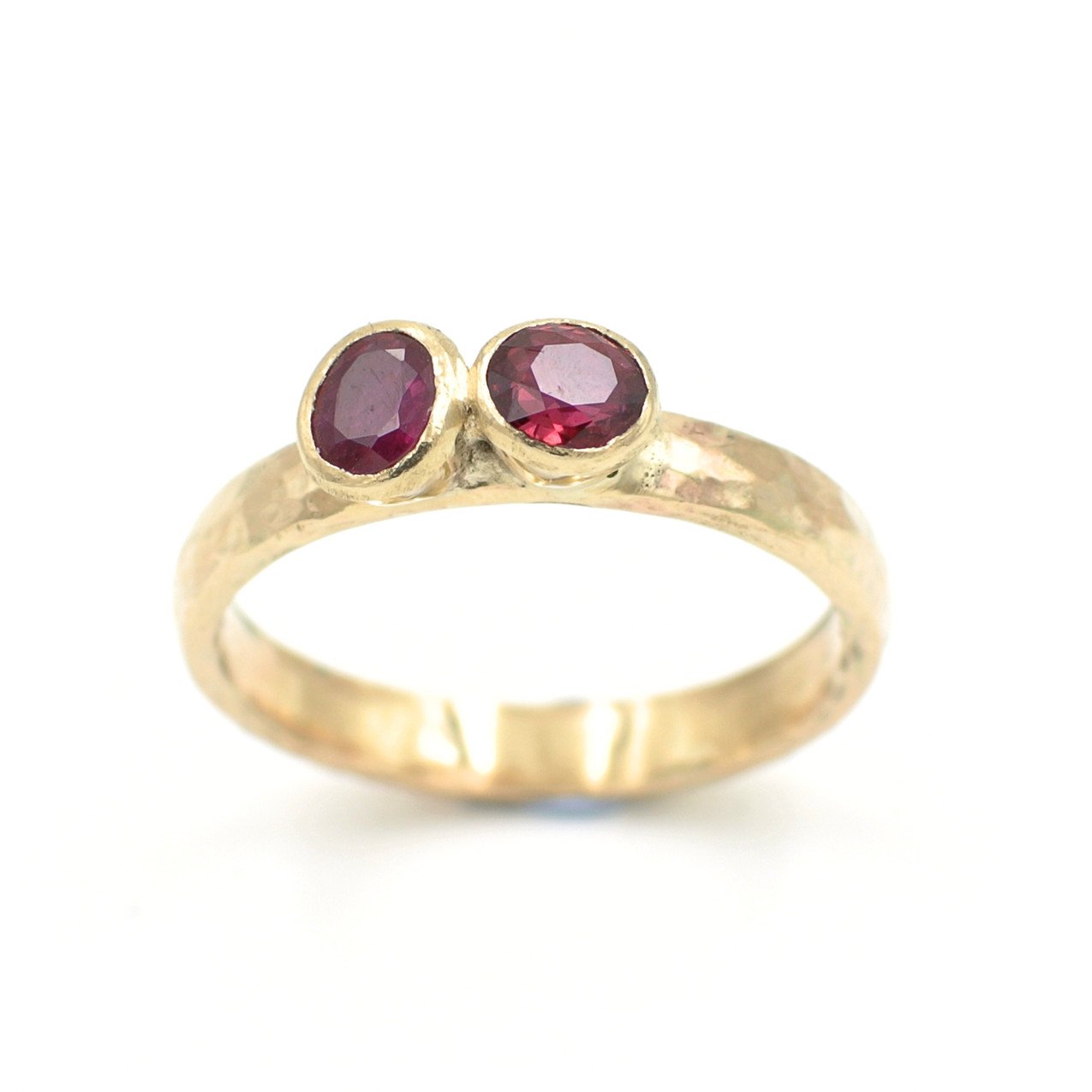 The finished piece, a remodelled ring using original ruby stones.
