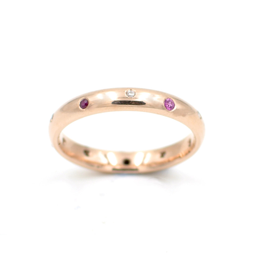Rose gold eternity ring flush set with diamonds, rubies and pink sapphires