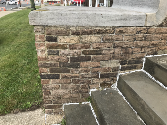 Left wing wall and slate steps