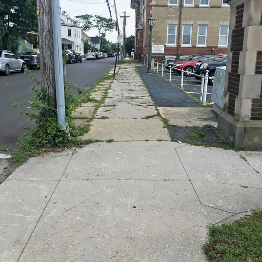 Lawrence Avenue Sidewalk view at the Corner of Main Avenue