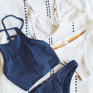Blue and white swimsuits