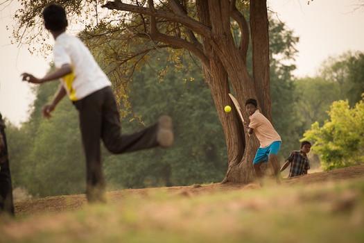 Boys Playing Cricket, India