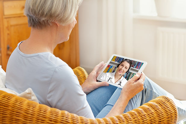 telemedicine concept, old woman with tablet pc during an online consultation with her doct