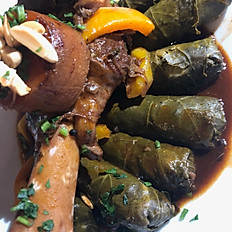 Lamb shanks with grape leaves
